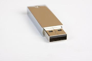 silver USB flash drive on white