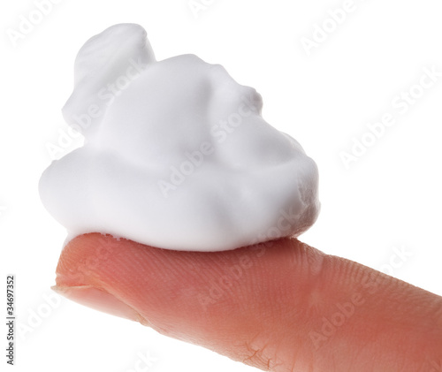 Shave foam (cream) sample on index finger, isolated on white