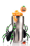 Halloween cup with spiders, hell candies, skeleton, lollipop