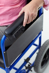 Detail of woman in wheelchair