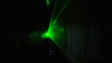 laser light is flashing in the dark disco