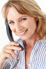 Mid age businesswoman on phone