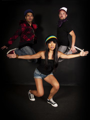 hip hop crew jumping and posing