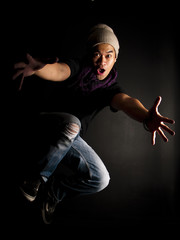 male hip hop dancer jumping