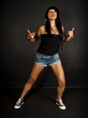 female hip hop dancer showing a shaka hand gesture