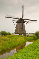 Dutch windmill (anno 1700) along a reflecting ditch