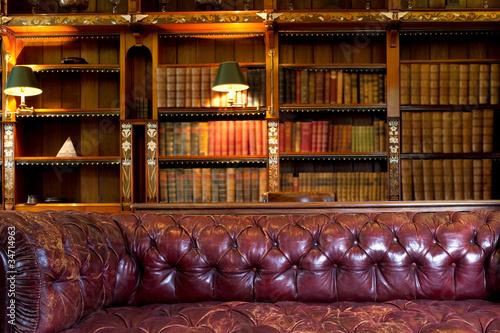 Leinwandbild Motiv Leather sofa and retro library