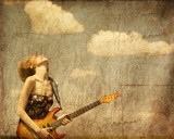 Red-head girl with guitar.