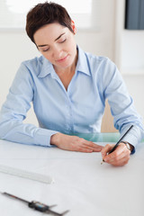 Woman working on an architectural plan