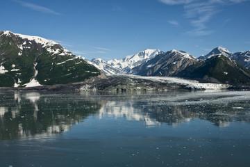 Wide shot on glacier reaching the sea in Alaska.