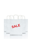 white shopping bags with the word sale on white