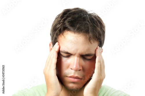 young man suffering from a headache isolated on white background