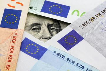 euro vs dollars: Franklin stare through space between euro