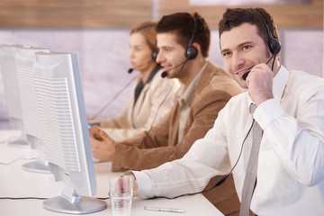 Cheerful customer servicer working in call center