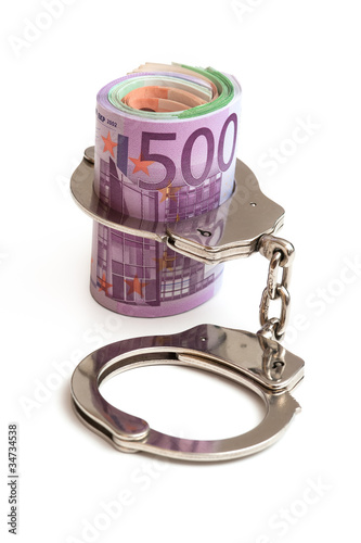 Handschellen und Euro Banknoten