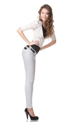 Full length portrait of coquettish female in jeans