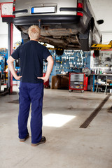 Mechanic Looking at Car