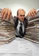 Businessman with big piles of paperwork