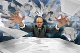 Serious businessman manipulating papers poster