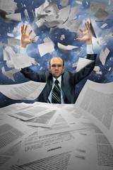 Serious businessman manipulating papers