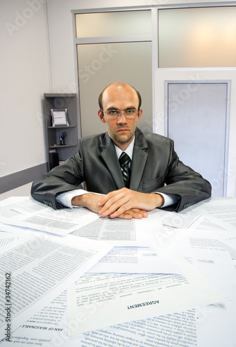 Serious businessman working in office