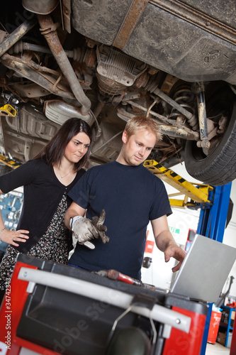 Mechanic with Sceptical Customer