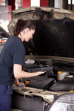 Woman Mechanic with Engine Diagnostics Tool