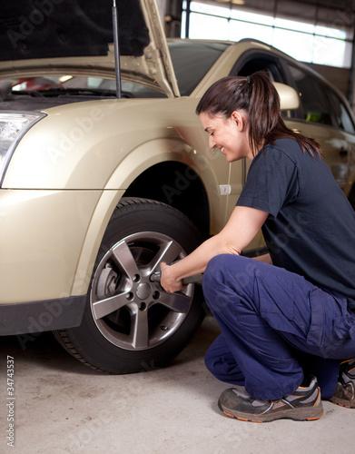 Woman Mechanic Tire Change