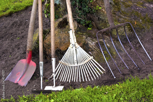 Leinwandbild Motiv Gartenarbeit
