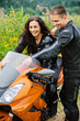 young couple with motorbike