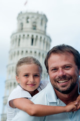 Family portrait in background the Leaning Tower in Pisa