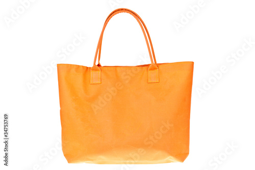 Colorful orange cotton bag on white isolated background.