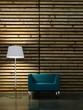 Wohndesign - blauer Sessel vor Holzwand