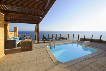 Terrace with a swimming pool in front of the sea