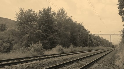 Historic steam train passing by. Filmed in sepia