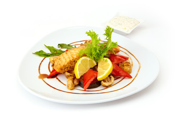 Red fish grilled with vegetables mushrooms lemon
