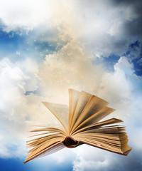 flying opened magic book