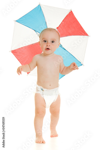 The kid with an umbrella on his head.