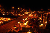Candle flames illuminating on cemetery during All Saint's Day - 34769548