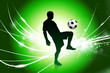 Soccer Player on Abstract Green Light Background