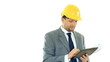 Construction engineer with tablet computer smiling, isolated