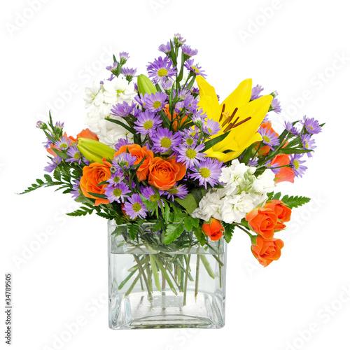 Keuken foto achterwand Gerbera Colorful flower arrangement centerpiece in square glass vase