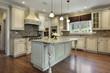 Kitchen with large granite island