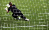 Soccer football goalkeeper making diving save
