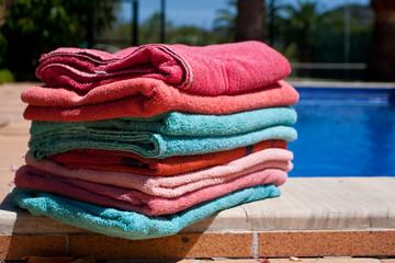 towels resting on pool edge