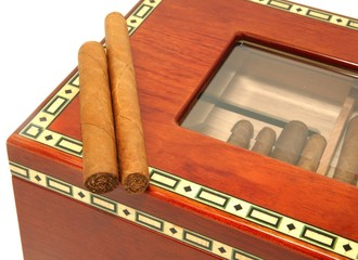 Two cigars on a humidor box