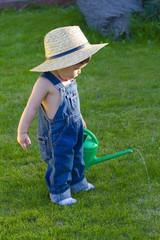 little baby boy gardener playing very professionally
