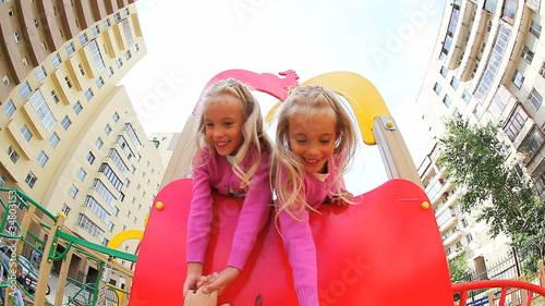 Two little girls having fun in playground