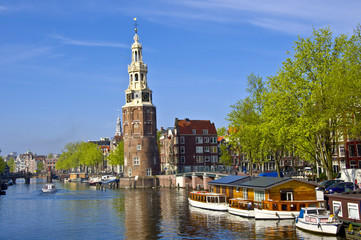Classical Amsterdam view. Boat floats