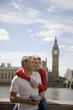 A middle-aged couple in front of the Houses of Parliament